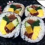 FUTO MAKI -- Cucumber, Takuwan, Shiitake mushroom, squash, spinach & egg (5 pieces)... $7.00
