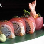 LAVA ROLL -- An explosion of heat and flavor! This shrimp tempura and avocado roll is topped with yellowfin tuna. Red-hot lava sauce is drizzled over the roll. Garnished with green onion (8 pieces)... $19.00